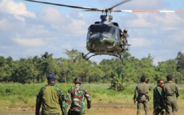 Jokowi Dituntut Minta Maaf dan Copot Kapolda Papua